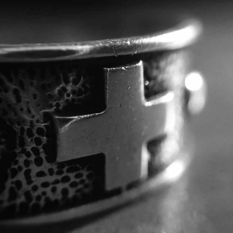 black and gray cross ring